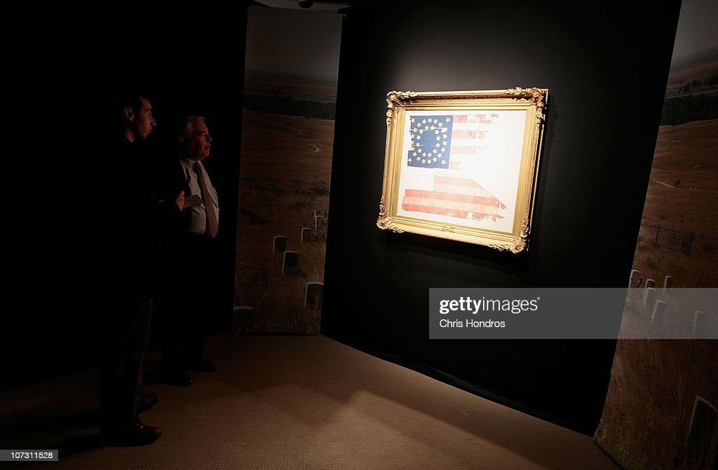 People look at 'Custer's Last Flag' at Sotheby's auction house December 3, 2010 in New York City. The flag, one of the few remnants of the famous 1876 battle in which General George Custer and his men were slaughtered by a band of Native American warriors after he staged a misgiuded attack, is billed as 'the most significant and symbolic artefact recovered from the Little Bighorn battlefield' and is scheduled to be auctioned on December 10.