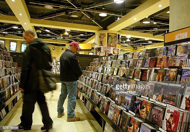 People look at DVD's for sale in a store May 25 2005 in New York City According to a report issued this week by the Book Industry Study Group the US...