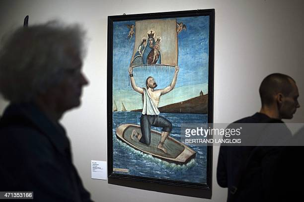 People look at 'Exvoto representant le miracle d'Andrea Anfosso' part of the 'Lieux Saints partages' exhibition held at the at the Museum of European...