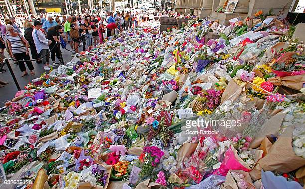 People look at floral tributes at Bourke St Mall for victims of the Bourke Street Mall Attack on January 25 2017 in Melbourne Australia Five people...