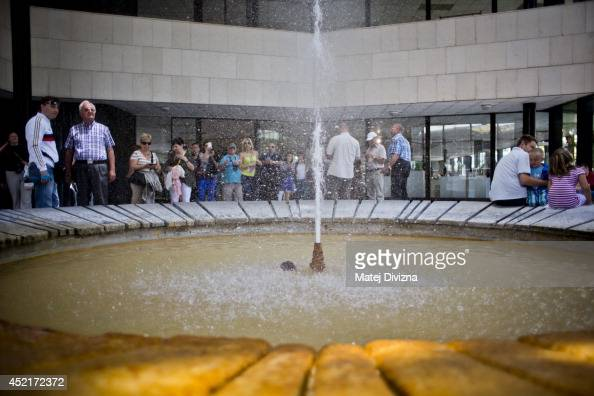 People look at hot spring in the Hot Spring Colonnade on July 12 2014 in Karlovy Vary Czech Republic Karlovy Vary known for its mineralrich waters...
