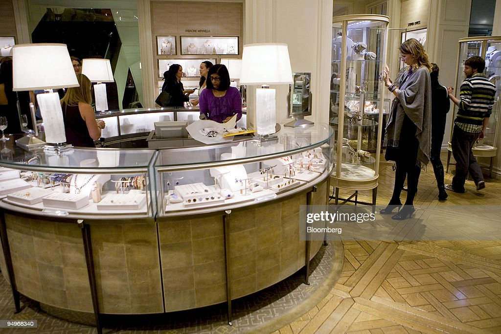 People look at jewelry displays at the Bergdorf Goodman stor