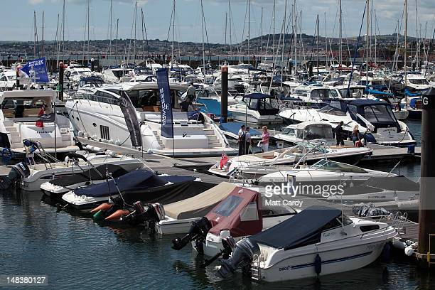People look at luxury yachts for sale in the marina at the Super Weekend on July 15 2012 in Torquay England Despite fears that suggest the UK's...