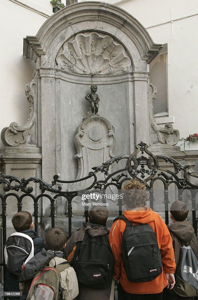People look at Manneken Pis near la Grande Place on February 19, 2008 in Brussels, Belgium.