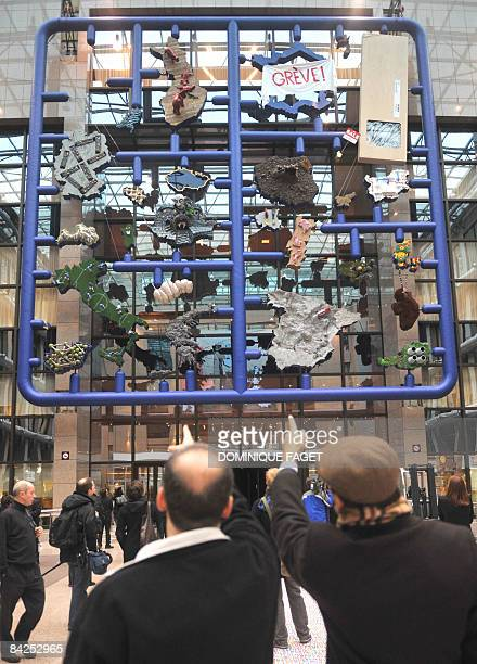 People look at modern art installation called 'Entropa' on January 12 2009 in the atrium of the European Council headquarters in Brussels The work...