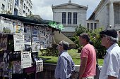 People look at newspapers' headlines in central Athens on June 25 2015 Greek Prime Minister Alexis Tsipras restarted critical talks with creditors in...