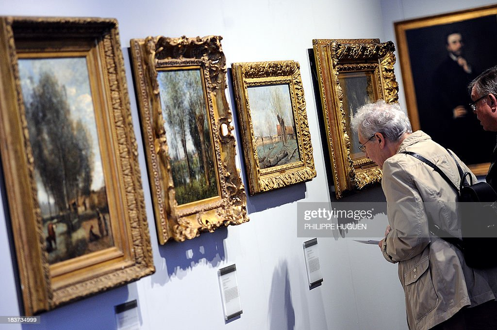 LAOUCHEZ People look at paintings by French painter Camille Corot during the exhibition 'Corot in the light of the North' on October 7, 2013 at the La Chartreuse museum in Douai, northern France. The event is held from October 5, 2013 to January 6, 2014. AFP PHOTO PHILIPPE HUGUEN