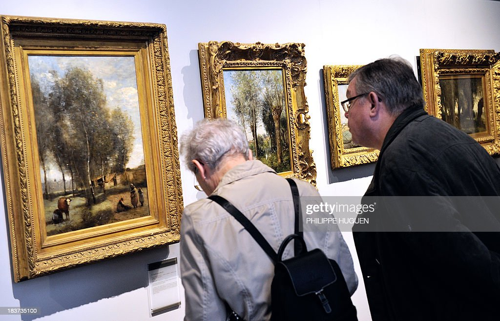 LAOUCHEZ People look at paintings by French painter Camille Corot during the exhibition 'Corot in the light of the North' on October 7, 2013 at the La Chartreuse museum in Douai, northern France. The event is held from October 5, 2013 to January 6, 2014.