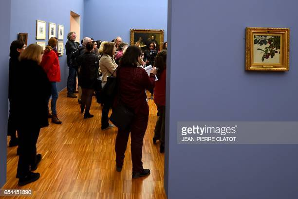 People look at paintings by French painter Henri FantinLatour and displayed during the retrospective exhibition 'FantinLatour A fleur de peau' at the...