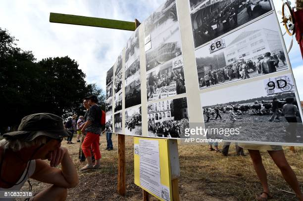 People look at pictures on display on a board as they attend a twoday meeting organised by opponents to a controversial international airport project...