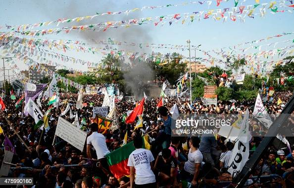 People look at smoke from an explosion which injured several people during a rally by the proKurdish People's Democratic Party on June 5 2015 in...