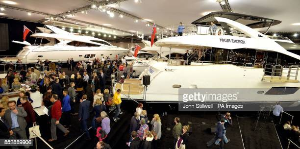 People look at the British built Sunseeker luxury Yacht range on the first day of the London Boat show 2014 at the ExcCel centre Docklands in east...