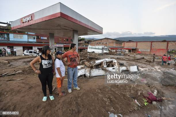 People look at the damage caused by mudslides following heavy rains in Mocoa Putumayo department southern Colombia on April 1 2017 Massive mudslides...