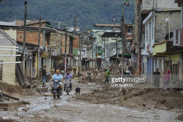 People look at the damage caused by mudslides following heavy rains in Mocoa Putumayo department southern Colombia on April 2 2017 The death toll...