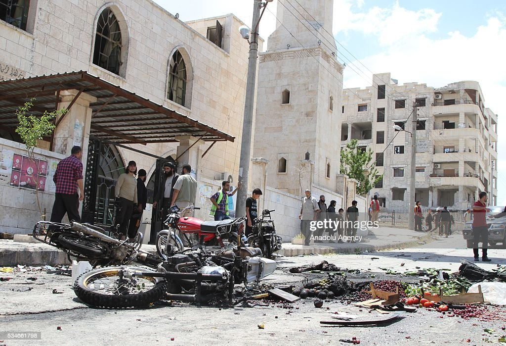 People look at the damaged motorcycles in front of the Suayb mosque after a car bomb attack during Friday prayer in Idlib, Syria on May 27, 2016.