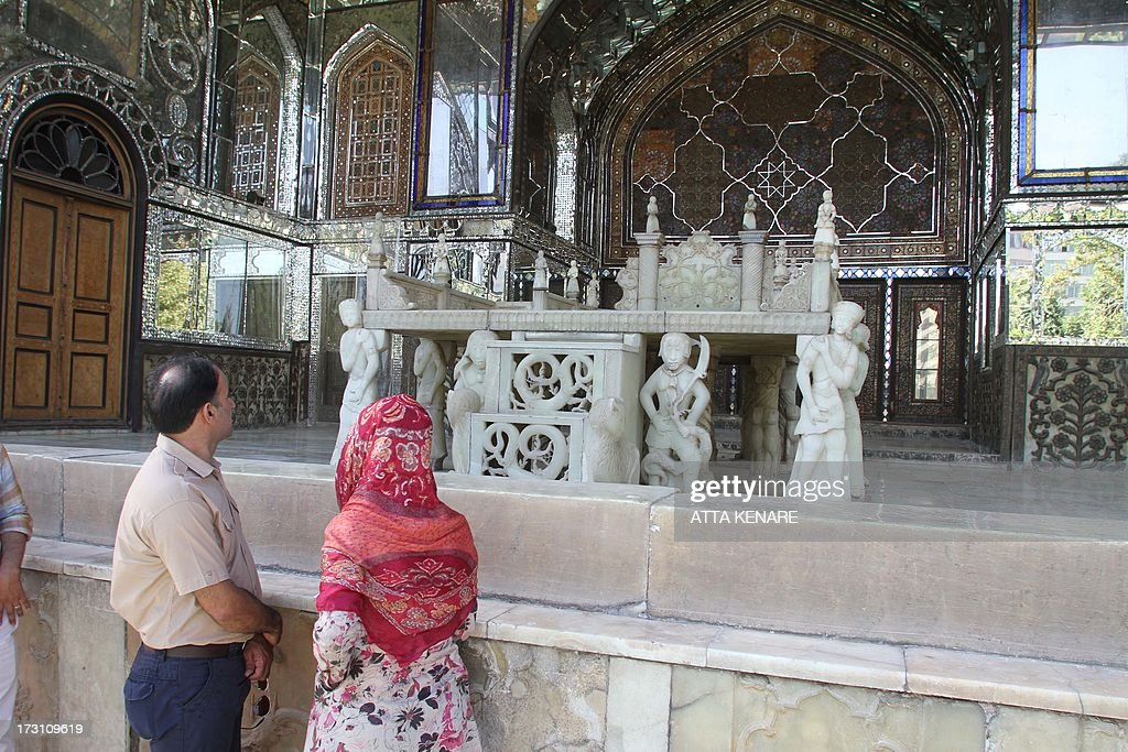 People look at the decorations of Tehran's Golestan Palace (The Rose Garden Palace) as the nation celebrates its inscription on the UNESCO World Heritage List on July 7, 2013. The palace, built in the 16th century, is a masterpiece of the art of the Qajar period.