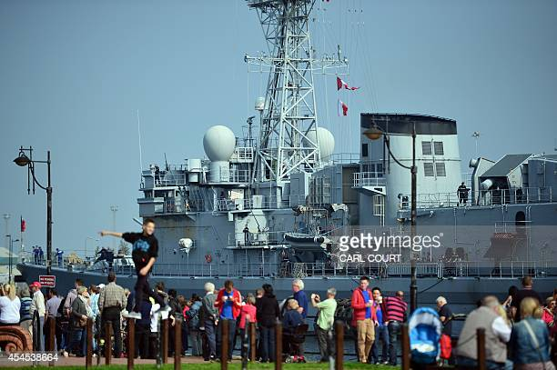 People look at the French naval vessel La MottePicquet docked Cardiff Bay in Wales on September 3 on the eve of the NATO summit Some 67 world leaders...