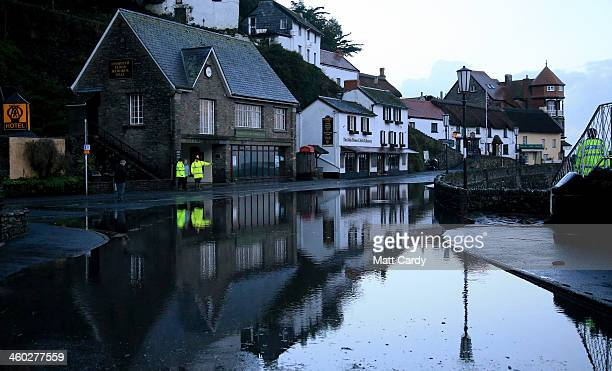 People look at the high tide flood water that still remains on the seafront at Lynmouth on January 3 2014 in North Devon England Storm and flood...