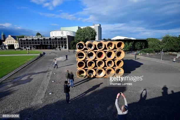 People look at the installation 'When We Were Exhaling Images' by the artist Hiwa K on June 7 2017 in Kassel Germany The documenta 14 is the...
