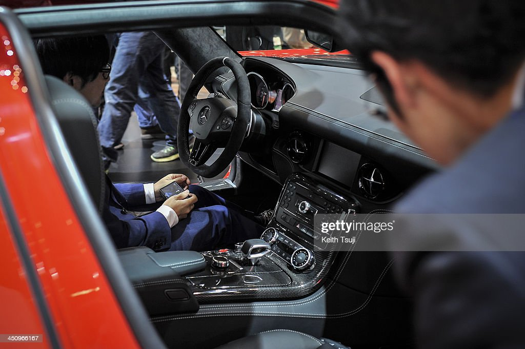 People look at the interior of the Mercedes-Benz SLS AMG GT Final Edition during the 43rd Tokyo Motor Show 2013 at Tokyo Big Sight on November 20, 2013 in Tokyo, Japan. The 43rd Tokyo Motor Show 2013 will be open to public from November 22nd to December 1st, 2013.