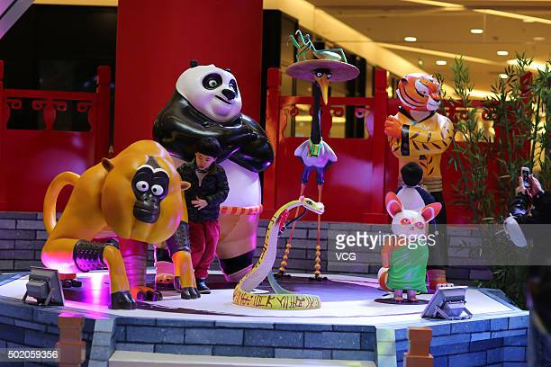 People look at the Kung Fu Panda 3 exhibition at a shopping mall on December 19 2015 in Kunming Yunnan Province of China Sculptures of cartoon roles...