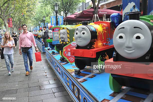 People look at the models of Thomas Friends exhibited at Shanghai Xintiandi on September 22 2015 in Shanghai China 70 onemetertall models of British...