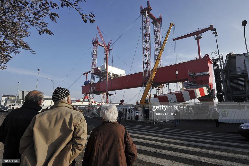 People look at the new goliath crane of the STX France shipyards of SaintNazaire western France taken on December 12 2013 The new crane currently...