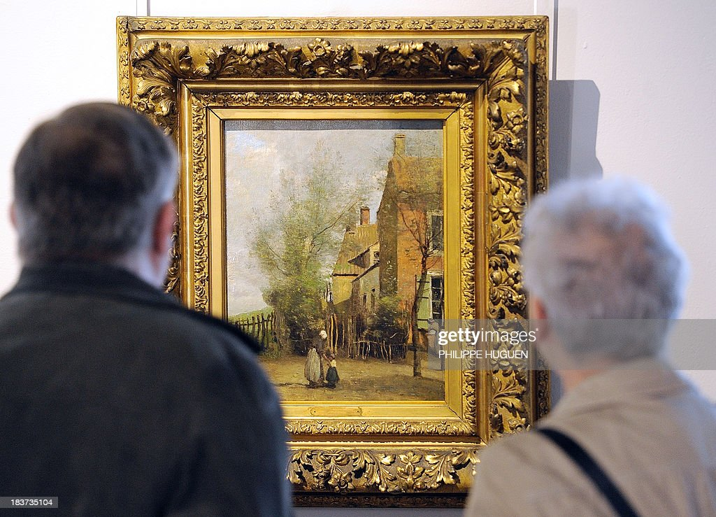 LAOUCHEZ People look at the painting 'Petites maisons villageoises avec une vieille femme et une petite fille' by French painter Camille Corot during the exhibition 'Corot in the light of the North' on October 7, 2013 at the La Chartreuse museum in Douai, northern France. The event is held from October 5, 2013 to January 6, 2014. AFP PHOTO PHILIPPE HUGUEN