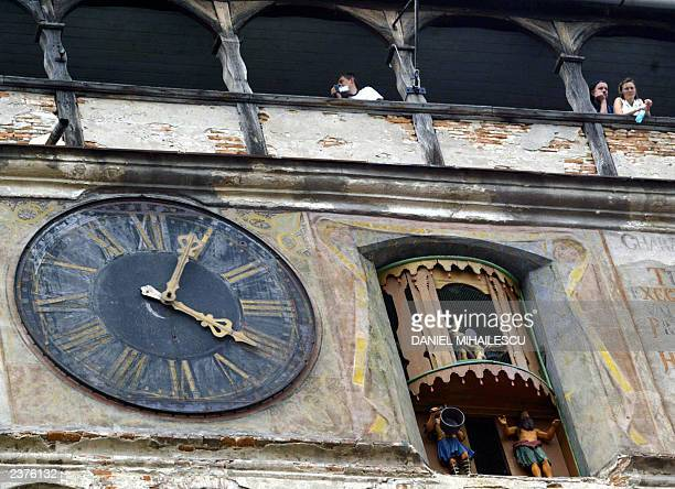 People look at the panorama of the city of Sighisoara from the 'Clock Tower' dated 1556 at the beginning of the Medieval Art Festival in Sighisoara...