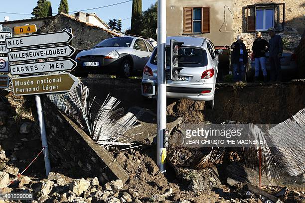 People look at the rubble in the aftermath of violent storms and floods in Biot southeastern France on October 4 2015 Violent floods along the French...