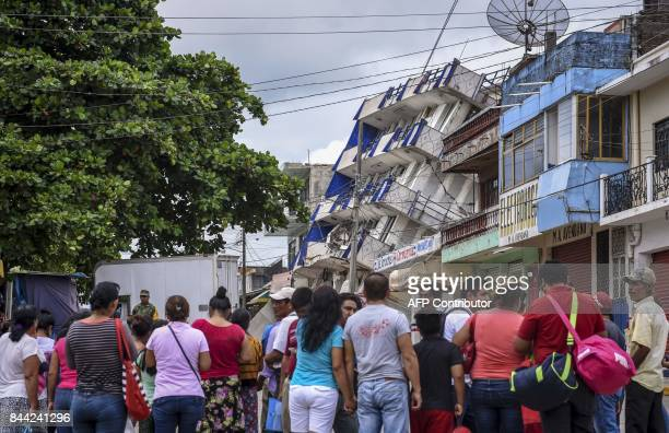 TOPSHOT People look at the Sensacion hotel which collapsed with the powerful earthquake that struck Mexico overnight in Matias Romero Oaxaca State on...