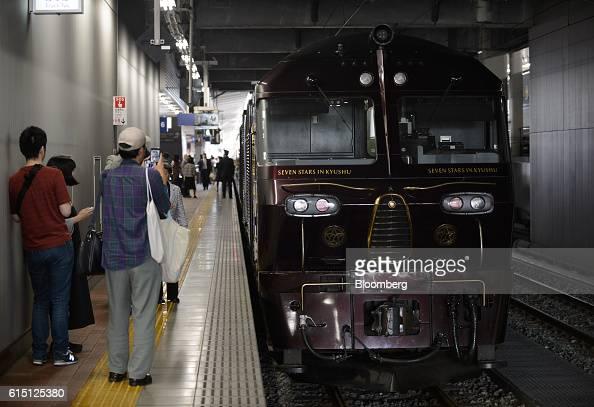 People look at the Seven Stars in Kyushu luxury train operated by Kyushu Railway Co at Hakata Station in Fukuoka Fukuoka Prefecture Japan on Tuesday...