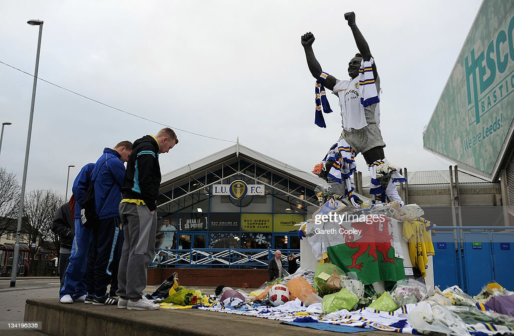 People look at the tributes left at the Billy Bremner statue outside Elland Road football ground in memory of former player Leeds United Gary Speed on November 28, 2011 in Leeds, England. Wales Manager Gary Speed, 42, was found dead on November 27, 2011 in Cheshire, England.