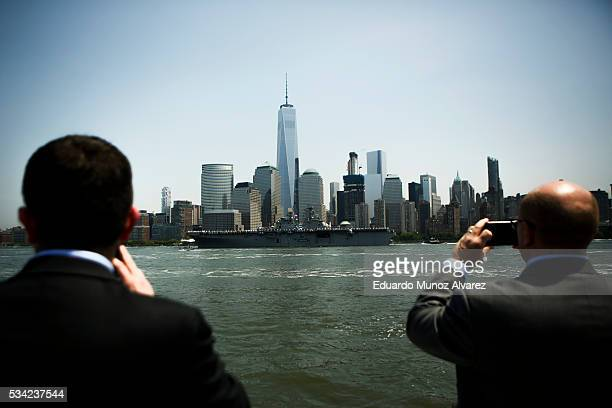 People look at the USS Bainbridge passes by World Trade Center while it arrives in New York Harbor for Fleet Week on May 25 2016 in New York City...