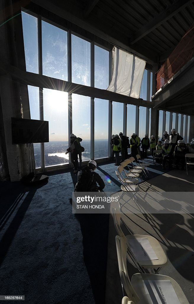 People look at the view as officials from The Durst Organization, Legends Hospitality LLC and The Port Authority of New York & New Jersey give a preview to the news media of the One World Observatory site, the planned public observation deck under construction on the 100th floor of One World Trade Center April 2, 2013 in New York. AFP PHOTO/Stan HONDA