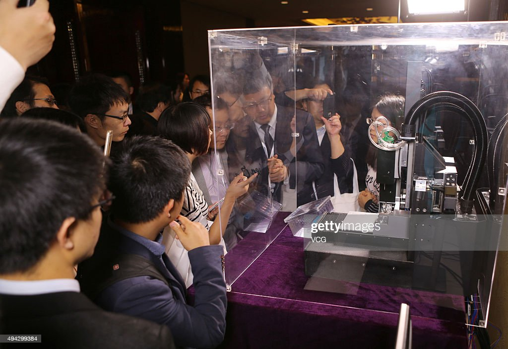 People look at the world's first 3D blood vessel bio-printer on October 25, 2015 in Chengdu, China. Sichuan Revotek Co., Ltd, a subsidiary of Sichuan BRC Group, is a biotechnological company and it launched the world's first 3D blood vessel bio-printer on Sunday.