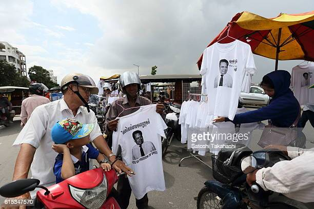 People look at Tshirt which printed a face of prominent political analyst Kem Ley during a funeral ceremony to mark 100 days since his death Kem Ley...