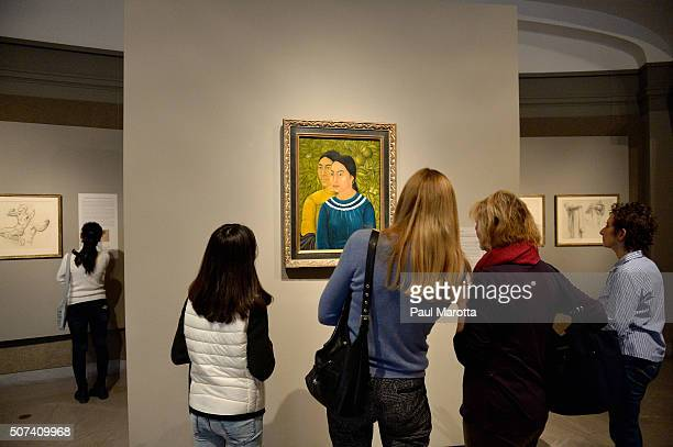 People look at 'Two Women' Dos Mujeres a rare painting by artist Friday Kahlo displayed at Museum Of Fine Arts Boston on January 29 2016 in Boston...