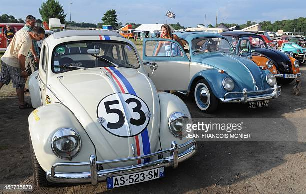People look at Volkswagen Beetles displayed during the 'Super VW Festival' on Le Mans' circuit western France on July 26 2014 The festival which runs...