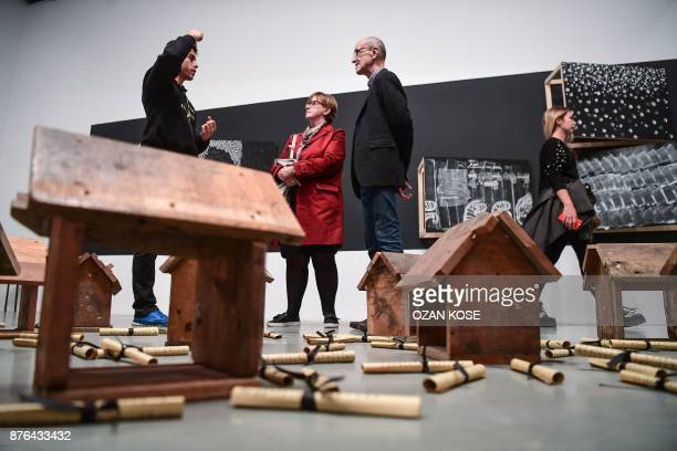 People look at works during the 15th Istanbul Biennial on November 3 2017 Almost immediately after the failed coup against Erdogan last year Turkish...