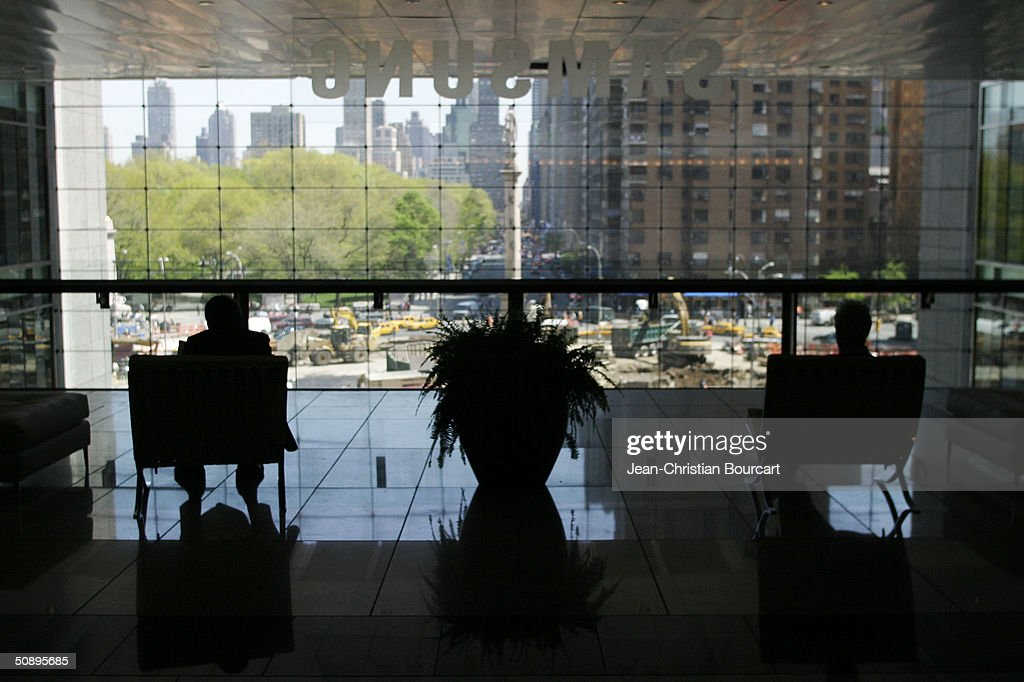 People look East from the third floor of the new Time Warner Building in Columbus Circle April 29, 2004 in the Manhattan borough of New York City. The building houses many businesses including the Time Warner World Headquarters, CNN offices, Five Star Mandarin Oriental Hotel, One Central Park Luxury Residences, restaurants and mall type shopping stores.