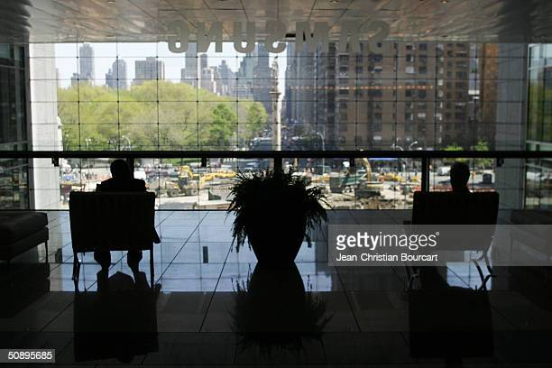 People look East from the third floor of the new Time Warner Building in Columbus Circle April 29 2004 in the Manhattan borough of New York City The...