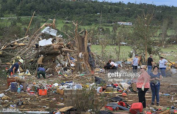 People look for items to salvage from a home that was destroyed when a tornado passed through the town on May 25 2011 in Etna Arkansas The storm...