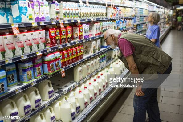 People look for milk products while shopping July 11 2014 at the Whole Foods supermarket in Washington DC Whole Foods is headquartered in Austin...