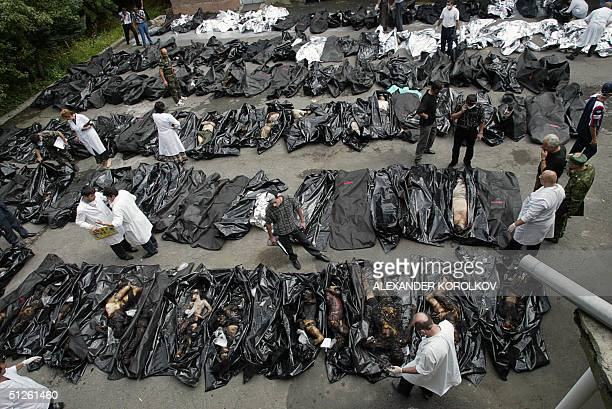 People look for relatives among the dead bodies of the Beslan hostagetaking drama victims at the morgue in Vladikavkz North Ossetia 04 September 2004...