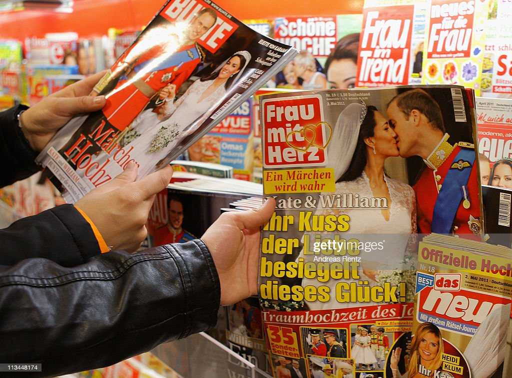 People look for the latest magazines of the wedding of the Royal Highnesses Prince William, Duke of Cambridge and Catherine, Duchess of Cambridge at a news stand on May 2, 2011 in Berlin, Germany. The marriage of the second in line to the British throne was led by the Archbishop of Canterbury and was attended by 1900 guests, including foreign Royal family members and heads of state April 29.