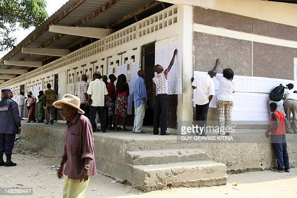 People look for their names on voters' lists at a polling station during the parliamentary elections in Brazzaville on July 15 2012 More than two...