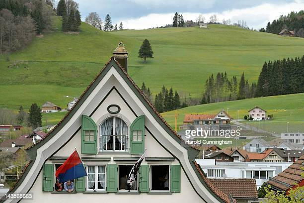 People look from a window at Appenzell Innerrhoden citizens taking part in a Landsgemeinde on April 29 2012 in Appenzell Switzerland The...