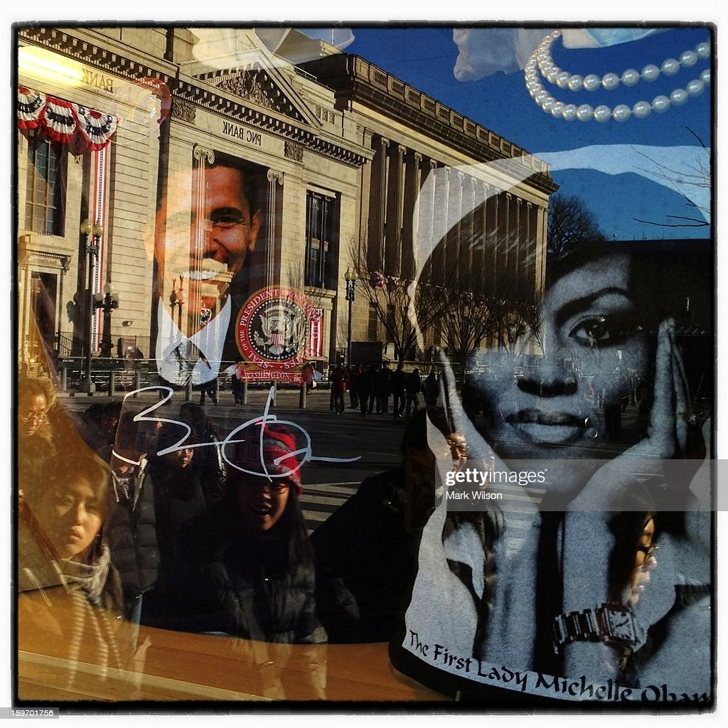 People look in the window of gift shop that sells presidential memorabilia as Washington prepares for President Barack Obama's second inauguration on January 18, 2013 in Washington, DC. The U.S. capital is preparing for the second inauguration of U.S. President Barack Obama, which will take place on January 21.