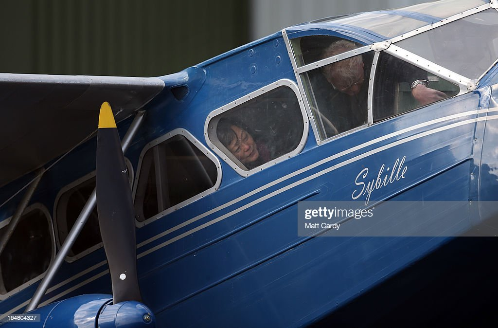 People look inside a historic 1930s de Havilland Dragon Rapide aircraft at the Classic Air Force museum, based at Newquay Cornwall Airport, as it prepares to open its doors to the public for the first time tomorrow, on March 28, 2013 in Newquay, England. The museum will eventually home a collection of vintage aircraft - the Classic Air Force, the only collection of flyable post-1945 British aircraft - and will include among the collection, the oldest British jet capable of flight (a 1948 Gloster Meteor) and the Canberra jet bomber that obtained the World Altitude Record for Britain in 1957. In total around 30 aircraft will ultimately be based in the Classic Air Force hanger with pleasure flights offered in a range of aircraft including a 1930s-era Dragon Rapide.